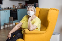 senior old woman in mask quarantine europe. Elderly at risk for coronavirus covid-19. Stay at home. Chinese virus pneumonia pandemic protection grandmother. danger of getting infected