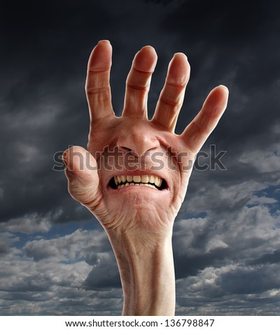 Senior pain and distress with the hand of an old retired person and a screaming suffering facial expression on the palm as a health care and medical concept of elderly physical   problems.