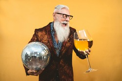 Senior party man celebrating new year's eve in disco club