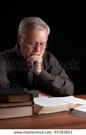 Senior pastor meditating and searching guidance