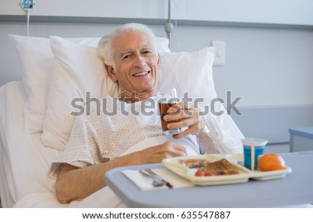 senior patient eating his lunch ...
