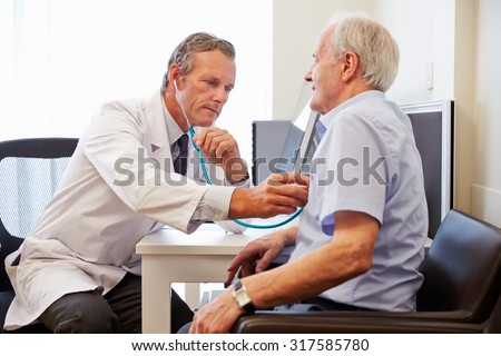 Senior Patient Having Medical Exam With Doctor In Office ストックフォト ©