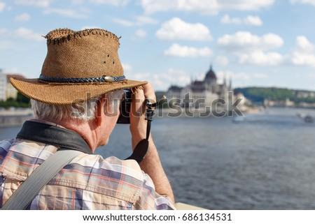 Senior pensioner tourist photographing Budapest panorama, Hungary, EU #686134531