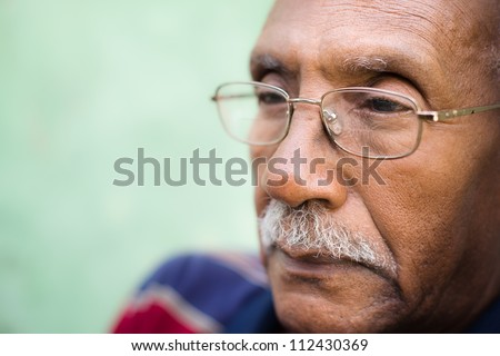 Senior people and feelings, portrait of sad old black man with glasses and mustache. Copy space