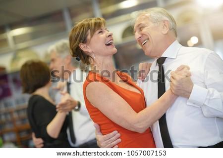 Senior people attending dance class #1057007153