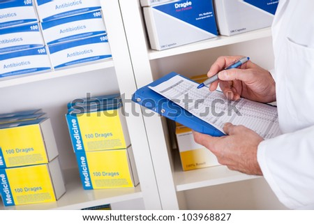 Senior pharmacist checking drugs at the drugstore