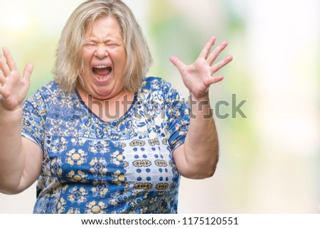 Senior plus size caucasian woman over isolated background celebrating crazy and amazed for success with arms raised and open eyes screaming excited. Winner concept