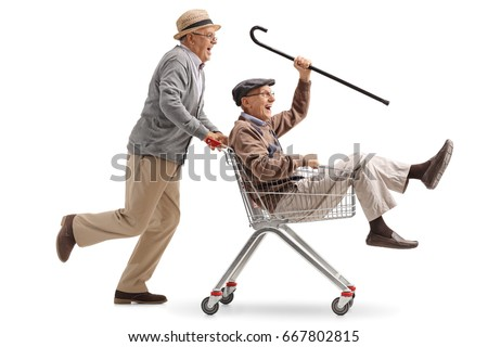 Senior pushing another senior in a shopping cart isolated on white background