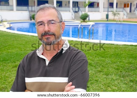 Senior retired man glasses relax on vacation garden pool