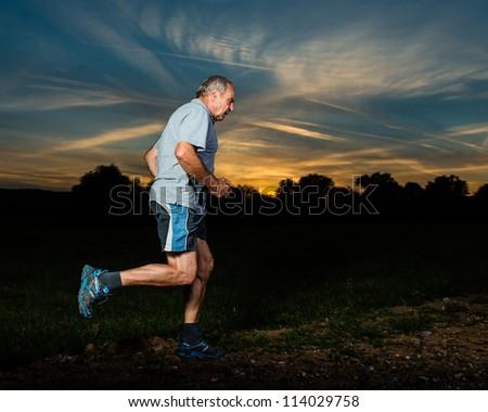 senior running in sunrise