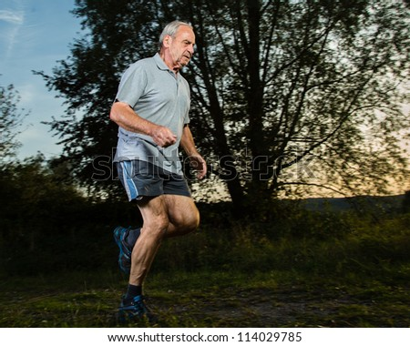 senior running in sunrise - stock photo