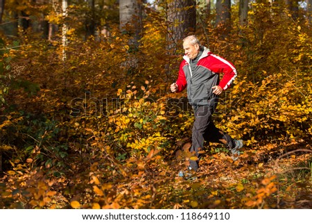 senior running through the forest