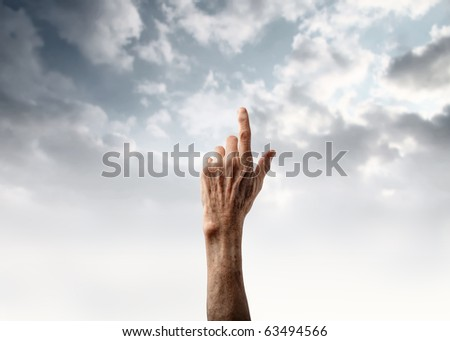 Senior's hand pointing at the sky