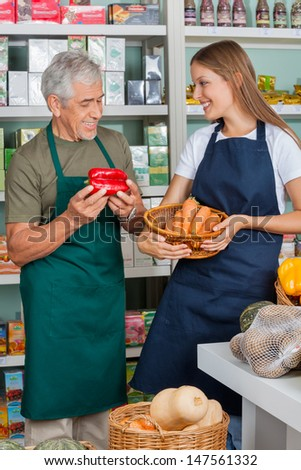 Senior salesman with female colleague working in supermarket
