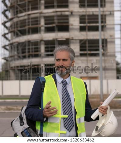 senior senior man buildings  senior manager building architect
