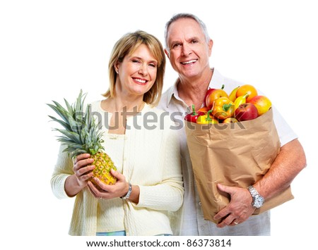 Senior shopping couple with grocery items . Isolated over white background.