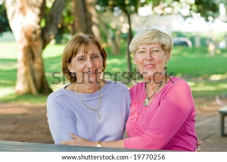 senior sisters and friends - stock photo