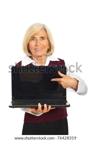 Senior smiling business woman pointing to blank laptop screen isolated on white background