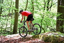 Senior Sporty bike with mountain bike in the woods