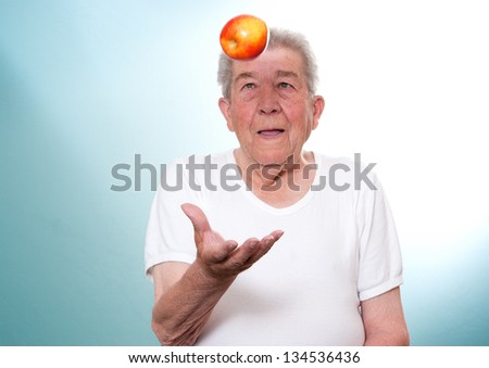 Senior throws an apple into the air