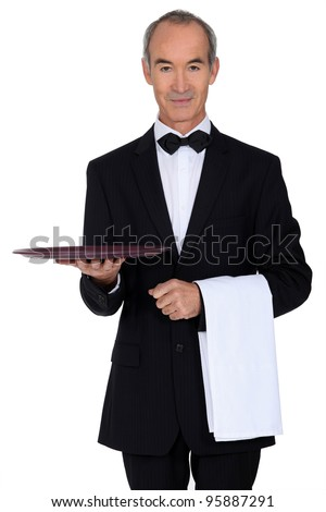 Senior waiter holding empty tray