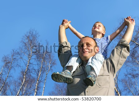 senior with child on shoulders in front of spring birch tree collage