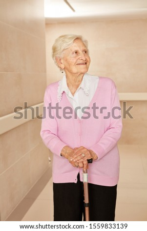 Senior with crutch in a nursing home or nursing home
