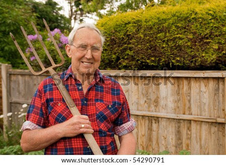 Senior with garden fork about to dig his vegetable patch