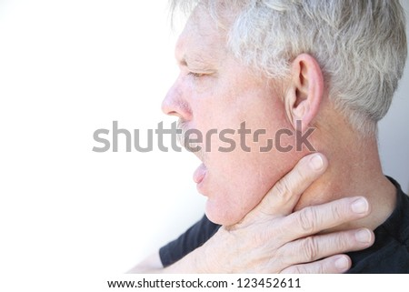 senior with mouth open and hand on jaw and neck