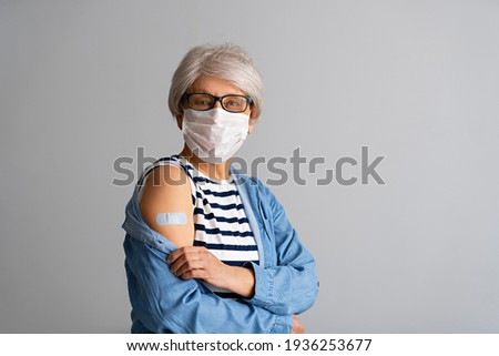 Senior woman after vaccination. Virus protection. COVID-2019.
