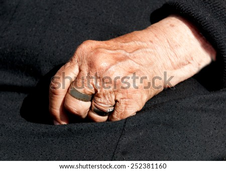 Senior woman  aged hand with fingers closed. Concept of aging process.