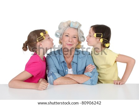 Senior woman and kids with hair curlers
