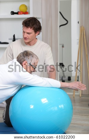 Senior woman and sports trainer