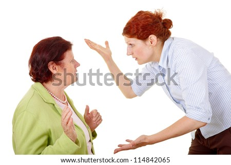 senior woman and young woman disputing about something.