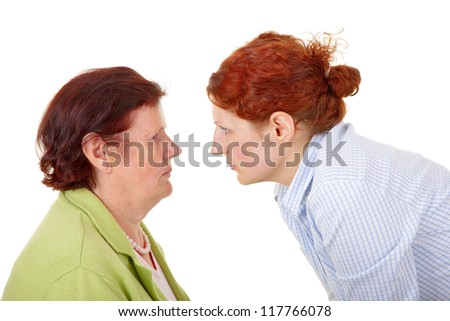 senior woman and young woman disputing about something. - stock photo