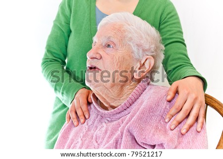 Senior woman and young woman over white background - stock photo