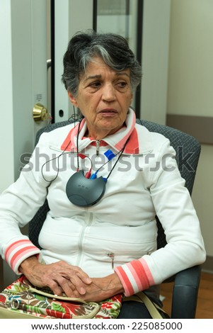 Senior woman at a hearing aid clinic. Person getting hearing aid devices, undergoing an audiogram in a health facility