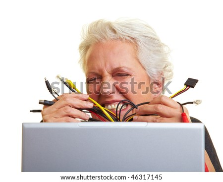 Senior woman at her laptop with many cables