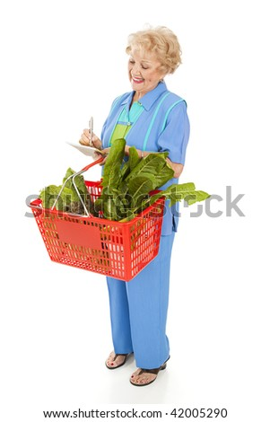 Senior woman at the grocery store, checking her shopping list.  Full body isolated.