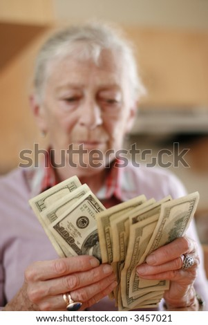 stock-photo-senior-woman-counting-savings-money-shallow-dof-focus-on-hands-3457021.jpg