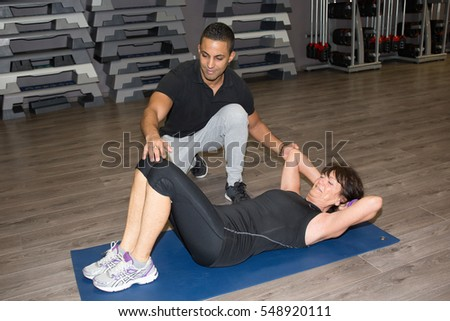 senior woman doing sport exercises with coach #548920111