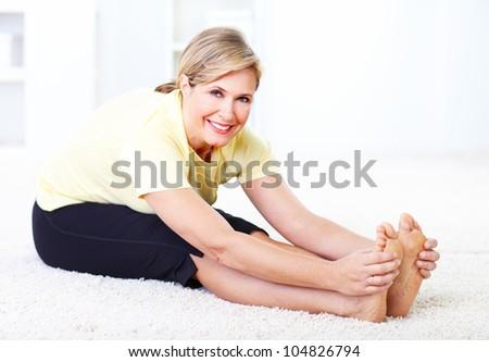 Senior woman doing yoga. Healthy lifestyle.