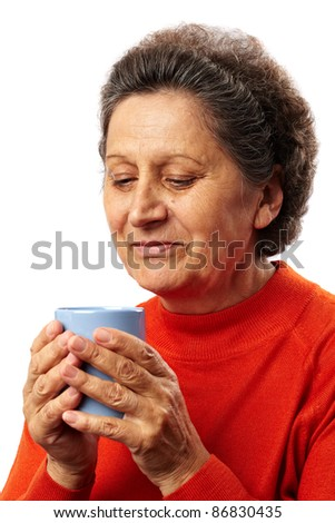 Senior woman drinking from a cup, isolated on white background