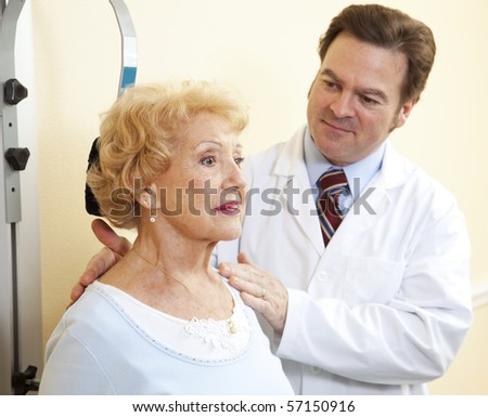 Senior woman exercising her neck with the help of a chiropractor.