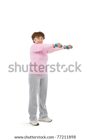 senior woman exercising in gym with dumbells