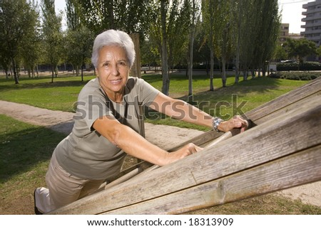 Senior woman exercising in the park #18313909