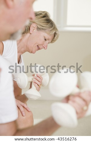 Senior woman exercising with hand weights