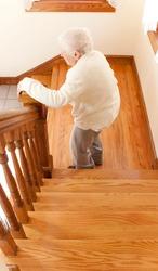Senior Woman going down staircase