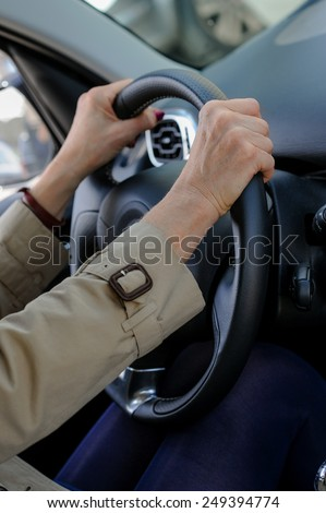 Senior woman hand on steering wheel of her car. #249394774