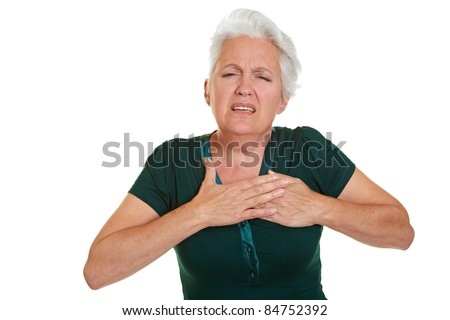 Senior woman having coronary and holding hand to her chest - stock photo